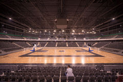 Lonely spectator in sports hall Royalty Free Stock Photo