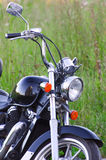 Lonely standing vintage motorcycle Stock Photography