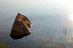 Lonely stone. The beauty of loneliness lights a way Royalty Free Stock Photos