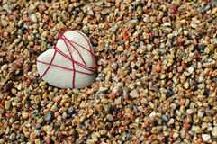 Lonely stone heart at a beach Royalty Free Stock Images