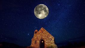 A Lonely Stone House with Moon Orbiting above