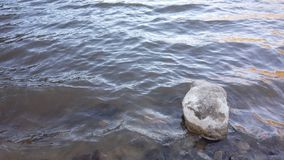 Lonely stone in Lake stock photos