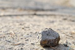 Lonely stone on a road Stock Photos