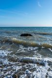 Lonely stone in the sea at the coast. Of Fontanka Village, Ukraine stock photo