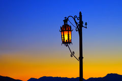 Lonely street lantern at sunset. Royalty Free Stock Image