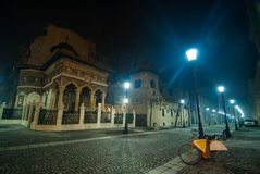 Solitude. A bicycle near a street light at nighttime in Bucharest Stock Photo