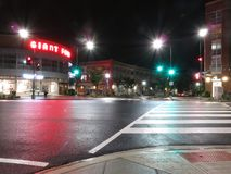 Lonely Street at Night in Washington DC. Photo of wisconsin avenue in washington dc at night on 6/20/18 with shopping center in background.  Time exposure of 13 Stock Photos