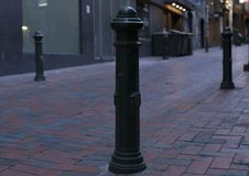 Lonesome street pole finally getting some love. Lonely street pole standing strong on brick alleyway finally getting some attention Stock Photos