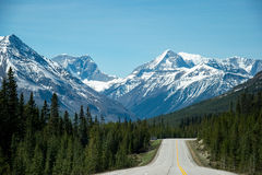 Lonely Street into the rocky mountains Stock Image