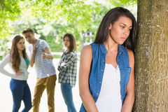 Lonely student being bullied by her peers. At the university Stock Photos