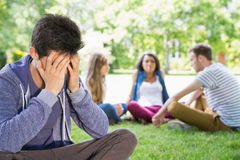 Lonely student feeling excluded on campus Stock Images