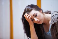 Lonely student with her head on her hand Royalty Free Stock Images