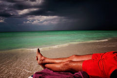 Lonely and successful men lying on the beach in Cuba Royalty Free Stock Photo