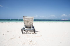 Lonely sunbed on the beach. Lonely sunbed on a Caribbean beach Royalty Free Stock Photos