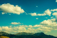 A lonely sunny mountain in autumn with clouds in spain stock image