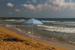 Lonely sunshade on the desert beach Stock Photography