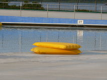Lonely Swim Rafts. After the local wave pool was closed for the day, these 2 rafts were stacked waiting to be picked up and put away for the night Stock Photo