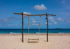 Lonely swing on the beach coast royalty free stock images