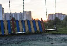 A lonely swing set. In the park stock photography