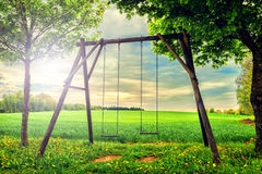 Lonely swing at summer sunset Royalty Free Stock Images