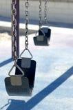 Lonely swings. Pair of swings in stillness Royalty Free Stock Photo