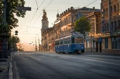 Lonely swiss tram in sunrise Soborna street Vinnytsia stock photography