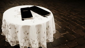 Lonely table on the street of an old city with menus lying stock footage