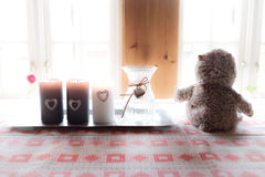 Lonely Teddy bear looking out the window. Concept of Nostalgia Royalty Free Stock Images