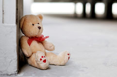 Lonely teddy bear. A sad and lonely Teddy Bear sittng on the ground waiting for somebody to play with him Stock Image