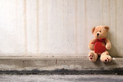 Lonely teddy bear. A sad and lonely Teddy Bear sittng on the ground waiting for somebody to play with him Stock Photo