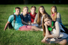 Lonely Teen with Group Royalty Free Stock Images