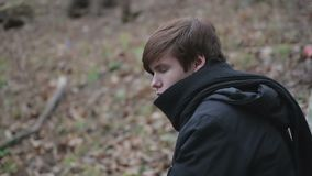 Lonely teenage emo guy having sad thoughts, depressive emotions after breakup. Stock footage stock footage