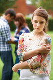 Lonely Teenage Girl Jealous Of Couple In Background Royalty Free Stock Photos