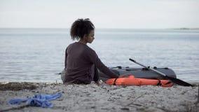 Free Lonely Teenage Girl Sitting Near Boat, Shipwreck Survivor On Desert Island Stock Photos - 161878193