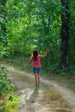 Lonely teenage girl in the spring forest. Teenage girl in the spring forest Royalty Free Stock Images