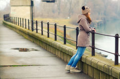 Lonely teenage girl standing outdoor on cold winter day Stock Photos