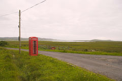 Lonely telephone box. Telephone box in Scotland, Isle of Islay royalty free stock photo