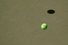 Lonely Tennis Ball. On a Sand Court stock photography