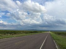 Lonely Texas Road. This lonely Texas two lane road stretches across the vast open expanses of West Texas royalty free stock photography