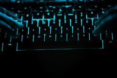 Lonely - text on illuminated computer keyboard at night. Internet search concept stock photo