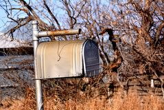 Lonely Times. Old Mailboxe standing alone in an abandon ghost town, waiting for another day of mail arrive Royalty Free Stock Photo