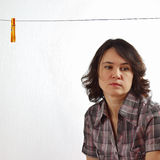 Lonely tired woman near an empty clothesline Stock Photography