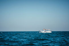 Lonely tourist boat in the Black Sea without people. Royalty Free Stock Image