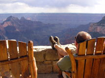 Lonely tourist looking at Grand Canyon North Rim royalty free stock photos
