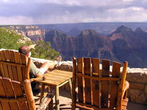 Lonely tourist looking at Grand Canyon North Rim royalty free stock photo