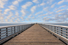 The lonely tourist at pier Royalty Free Stock Image