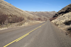 Lonely Tow Lane Divided Highway Cuts Through Dry Hills Landscape Royalty Free Stock Photography