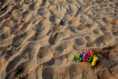 A lonely toy on the beach Stock Photos