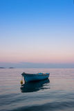 Lonely traditional greek fishing boat on sea water Stock Image
