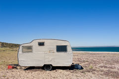 Lonely trailer by the shore. Stock Photos